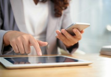 hands-anonymous-business-woman-using-digital-tablet-smartphone-work-min_optimized